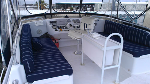 bench setees on both sides of boat in a navy striped upholstgery